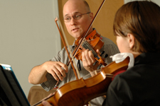 teacher and pupil in violin lesson